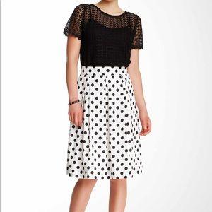White skirt with black polka dots
